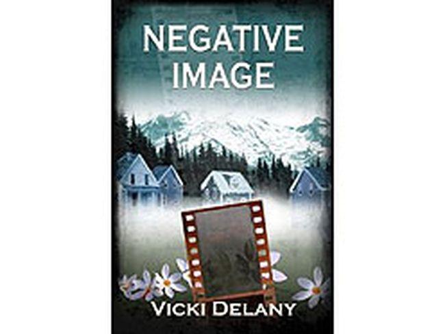 NEGATIVE IMAGE by Vicki Delany (Poisoned Pen Press, $24.95)