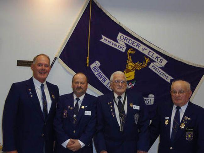 From left, Dennis Botterill, Jackie Hazelwood, exalted ruler, George Botterill, Eugene Rawlyk, secretary.