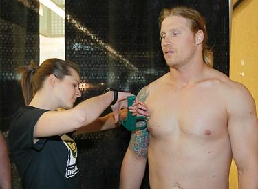 Mathieu Bertrand gets his fat percentage measured during Edmonton Eskimos medicals and fitness testing at Commonwealth Stadium in Edmonton, Alta. on Saturday June 4, 2011. (PERRY NELSON/EDMONTON SUN)