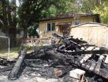 A 2011 file photo shows a garage arson in Fort Rouge. ROSS ROMANIUK/Winnipeg Sun files