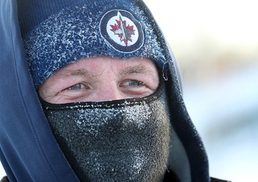 Assiniboine Park employee Scott Longstaffe is covered in frost while working on icing the duck pond in Winnipeg on Thursday, Jan. 19, 2012. (Brian Donogh, Winnipeg Sun)