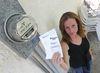 Cindy Flett holds up her Hydro bill. (CHRIS PROCAYLO/Winnipeg Sun)