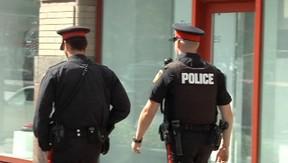 Police patrol in downtown Winnipeg on Wednesday, August 29, 2012. (Image from Winnipeg Sun video)