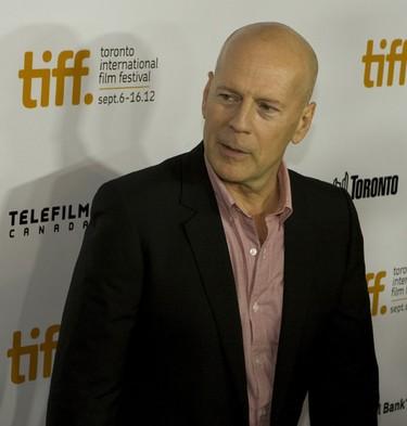 "Bruce Willis arrives at the gala presentation for the film ""Looper"" during the 37th Toronto International Film Festival September 6, 2012.  (Jack Boland/QMI Agency)"