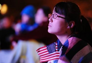Kim Li, a junior at Denver University, watches the first 2012 U.S. presidential debate between U.S. President Barack Obama and Republican presidential nominee Mitt Romney on an outdoor screen at Denver University in Denver, Colorado October 3, 2012. REUTERS/Mark Leffingwell