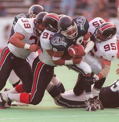 June 16, 1996 -- Toronto Argos Robert Drummond gets tackled by most of the Ottawa Rough Riders during an exhibition game at Ottawa's Frank Clair Stadium.       OTTAWA SUN/JEFF BASSETT