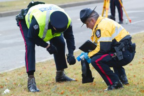 Police investigate after a teenage pedestrian was killed in a hit and run on 82 Street at 141 Avenue in Edmonton, Alberta on Sunday, October 14, 2012.  AMBER BRACKEN/EDMONTON SUN/QMI AGENCY