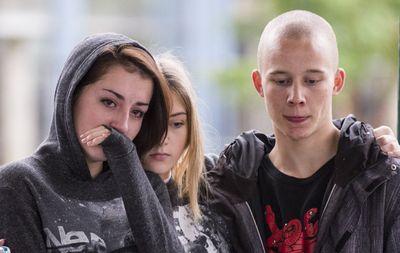 People get emotional during a vigil and memorial for Amanda Todd in Maple Ridge, British Columbia, Oct. 15, 2012. (Carmine Marinelli/QMI Agency)