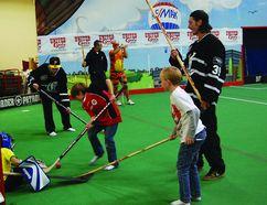 Kids play floor hockey at last year's Hallo-Baloo festivities at Millennium Place. File Photo