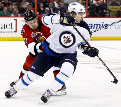 Ottawa Senator Milan Michalek pursues Alexander Burmistrov of the Winnipeg Jets during third period action at Scotiabank Place. Thursday October 20,2011. (ERROL MCGIHON/THE OTTAWA SUN/QMI AGENCY).