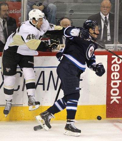 Pittsburgh Penguins center Joe Vitale (l) and Winnipeg Jets center Alexander Burmistrov fight for the puck during NHL hockey in Winnipeg Friday, December 23, 2011. BRIAN DONOGH/WINNIPEG SUN/QMI AGENCY