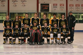 The Fairview Boyt's Bantam Bruins team and staff pose for a team photo at the Fairview Fairplex on Oct. 6. (Simon Arseneau/Fairview Post)