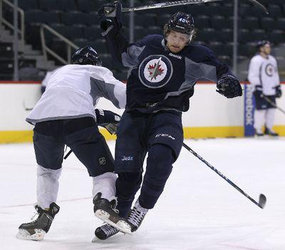 Winnipeg Jets forward Maxime Macenauer dodges a check from defenceman Ron Hainsey during hockey practice at the MTS Centre in Winnipeg, Man., on Fri., Jan. 11, 2013. (JASON HALSTEAD/Winnipeg Sun)