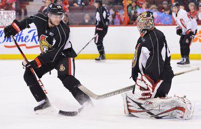Ottawa Senators #61 Andre Benoit takes a shot on the Senators goalie #41 Craig Anderson during their practice on Sunday, Jan. 13, 2013. (Matthew Usherwood/ Ottawa Sun)
