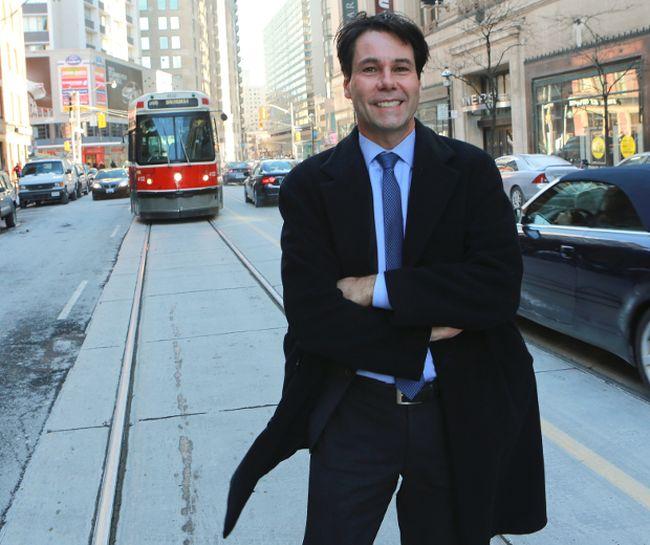 Eric Hoskins poses on a Toronto street. (DAVE THOMAS, Toronto Sun)