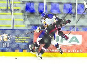 Tyler Polanski of the Junior B Hawks lays a hit on a Leduc Riggers skater in Fort Saskatchewan's 6-4 victory Sunday night. Aaron Taylor/QMI Agency/Fort Saskatchewan Record