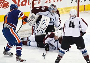 Edmonton's Taylor Hall takes a shot on Colorado's Semyon Varlamov during the Edmonton Oilers' NHL hockey game against the Colorado Avalanche at Rexall Place in Edmonton, Alta., on Monday, Jan. 28, 2013. Codie McLachlan/Edmonton Sun/QMI Agency