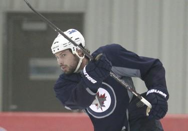 Injured Winnipeg Jets defenceman Zach Bogosian fires a shot during a light skate in Winnipeg, Man. Monday Feb. 04, 2013. BRIAN DONOGH/WINNIPEG SUN/QMI AGENCY