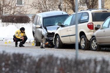 Edmonton city police investigates a crash involving several vehicles and a police car on 106 ave and 96 st in Edmonton, AB., on Feb 8, 2013.   Perry Mah/Edmonton Sun/Qmi Agency