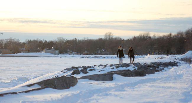 People walk near Breakwater Park, along the shoreline of Lake Ontario. (Whig-Standard file photo)