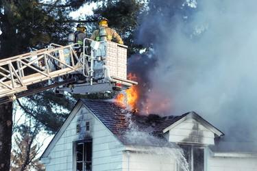 Ottawa Firefighters control a house fire on Kenwood Avenue in the city's west end on Saturday February 16,2013. Errol McGihon/Ottawa Sun/QMI Agency