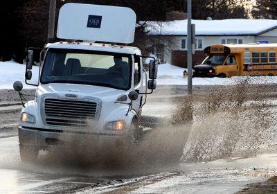 A truck makes it's way through a large puddle along 98 Avenue near, Terrace Road, in Edmonton, Alta. on Monday Feb. 11, 2013. David Bloom/Edmonton Sun/ QMI Agency
