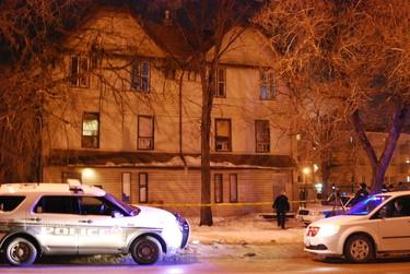 Police were investigating outside a rooming house on Balmoral Street on Tuesday, Feb. 26, 2013. (TESSA VANDERHART/Winnipeg Sun)