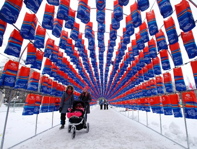 People walk through a Chinese lantern tunnel during the Winterlude winter festival at Confederation Park in Ottawa, Saturday, Feb. 2, 2013. Darren Brown/Ottawa Sun/QMI Agency)