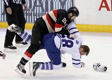 Ottawa Senator Matt Kassian and Toronto Maple Leafs Colton Orr fight during NHL hockey action at Scotiabank Place in Ottawa on Saturday March 30,2013. Errol McGihon/The Ottawa Sun/QMI Agency