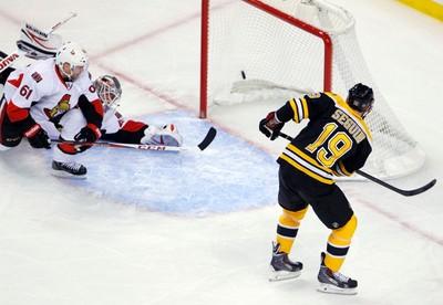 Boston Bruins' Tyler Seguin (R) scores against Ottawa Senators goaltender Robin Lehner (C) as Senators' Andrew Benoit skates in to defend during the first period of their NHL hockey game at TD Garden in Boston, Massachusetts April 2, 2013. REUTERS/Jessica Rinaldi (UNITED STATES - Tags: SPORT ICE HOCKEY)