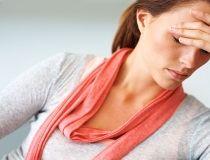 Woman with a headache - stress stressful head pain