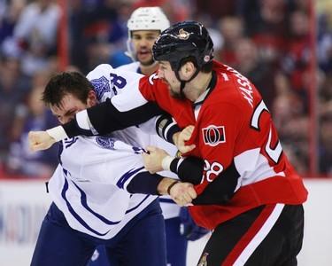 Ottawa Senators' Matt Kassian (R) fights Toronto Maple Leafs' Frazer McLaren during the first period of their NHL hockey game in Ottawa April 20, 2013. (REUTERS/Blair Gable)