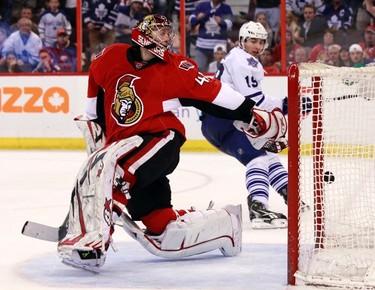 Toronto Maple Leafs' Joffrey Lupul scores on Ottawa Senators' goalie Craig Anderson during the third period of their NHL hockey game in Ottawa April 20, 2013.     (REUTERS/Blair Gable)