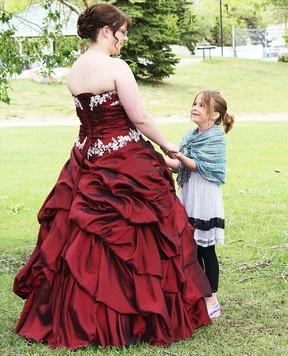 This little girl admires the gown worn by Koosha Bradley-Burger during grad weekend held this past weekend in Wetaskiwin.