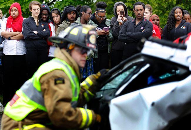 Louis Riel students watch firefighters cut open drunk driving car