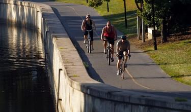 People cycle along the Rideau Canal near Hog's Back Monday July 15, 2013.  Darren Brown/QMI Agency/Ottawa Sun