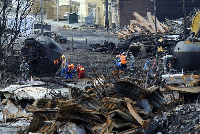 Workers clean up the site of the Lac-Megantic train derailment tragedy. (Stevens Leblanc/QMI Agency Files)