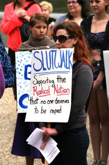 A woman holds a protest sign during the annual Slut Walk at the Alberta Legislature in Edmonton, Alberta on Saturday, July 27, 2013.  Perry Mah/Edmonton Sun/QMI Agency