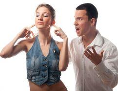 Woman tunes out her spouse. (Fotolia.com)