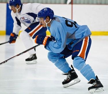 Ryan Nugent-Hopkins takes part in a riot test during Edmonton Oilers training camp at Millennium Place in Sherwood Park, Alta., on Thursday, Sept. 12, 2013. Codie McLachlan/Edmonton Sun/QMI Agency