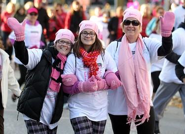 Participants wave during the Run For the Cure in Winnipeg, Man. Sunday October 06, 2013. BRIAN DONOGH/WINNIPEG SUN/QMI AGENCY