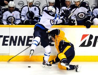 Oct 24, 2013; Nashville, TN, USA; Winnipeg Jets center Mark Scheifele (55) hits Nashville Predators center Filip Forsberg (9) during the second period at Bridgestone Arena. Mandatory Credit: Mike Strasinger-USA TODAY Sports