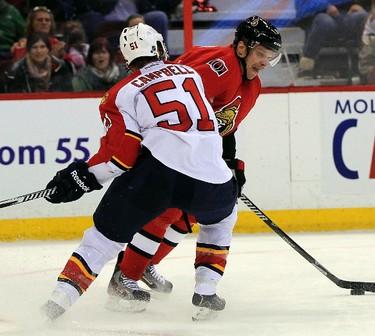 Ottawa Senators' Milan Michalek (9) tries to beat Florida Panthers' Brian Campbell (51) in the third period during NHL action at the Canadian Tire Centre in Ottawa, Ont. on Saturday November 9, 2013. The Senators won 3-2.  Darren Brown/Ottawa Sun/QMI Agency