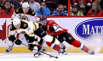 Ottawa Senators' Mark Borowiecki gets tripped by Boston Bruins' Carl Soderberg and Reilly Smith during NHL action in Ottawa, Ont. on Friday November 15, 2013. Errol McGihon/Ottawa Sun/QMI Agency