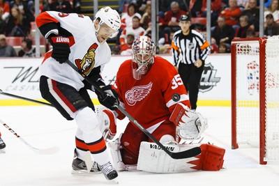Nov 23, 2013; Detroit, MI, USA; Detroit Red Wings goalie Jimmy Howard (35) makes a save on Ottawa Senators left wing Milan Michalek (9) in the third period at Joe Louis Arena. Mandatory Credit: Rick Osentoski-USA TODAY Sports