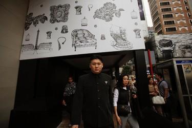 Australian Chinese Howard, 34, who does not disclose his last name, appears as a North Korean leader Kim Jong-un lookalike on a street at Hong Kong's Tsim Sha Tsui shopping district November 27, 2013. REUTERS/Bobby Yip