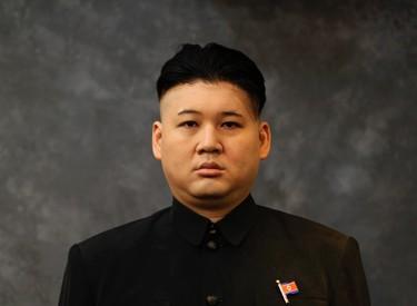 Australian Chinese Howard, 34, who does not disclose his last name, poses after having a haircut and make-up applied to turn himself into a North Korean leader Kim Jong-un lookalike at a hair salon in Hong Kong November 27, 2013. REUTERS/Bobby Yip