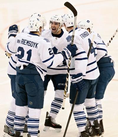 Toronto Maple Leafs celebrate a goal against the Ottawa Senators during first period NHL Hockey at the Canadian Tire Centre in Ottawa on Saturday, Dec. 7, 2013. (Matthew Usherwood/ Ottawa Sun/ QMI Agency)
