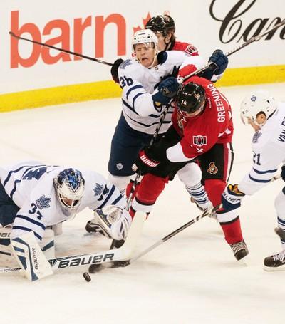 Ottawa Senators Colin Greening (14) takes a shot on the Toronto Maple Leafs goaltender James Reimer (34) during first period NHL Hockey at the Canadian Tire Centre in Ottawa on Saturday, Dec. 7, 2013. (Matthew Usherwood/ Ottawa Sun/ QMI Agency)
