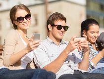 Three people with phones